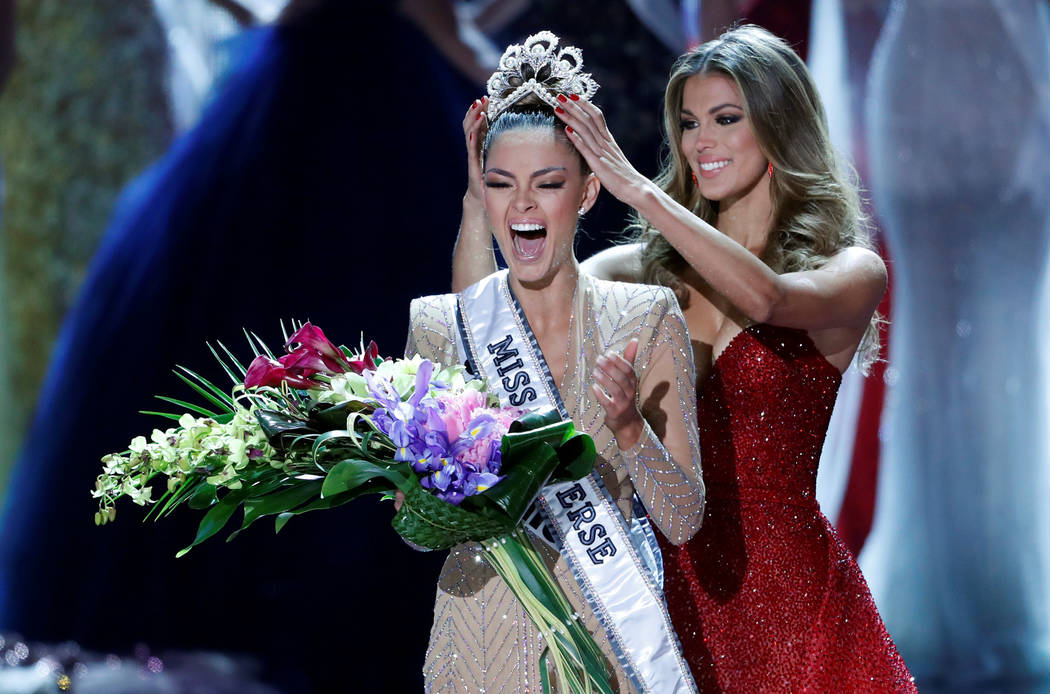 Miss South Africa Demi-Leigh Nel-Peters reacts as she is crowned by Miss Universe 2016 Iris Mittenaere during the 66th Miss Universe pageant at Planet Hollywood hotel-casino in Las Vegas, Nevada,  ...