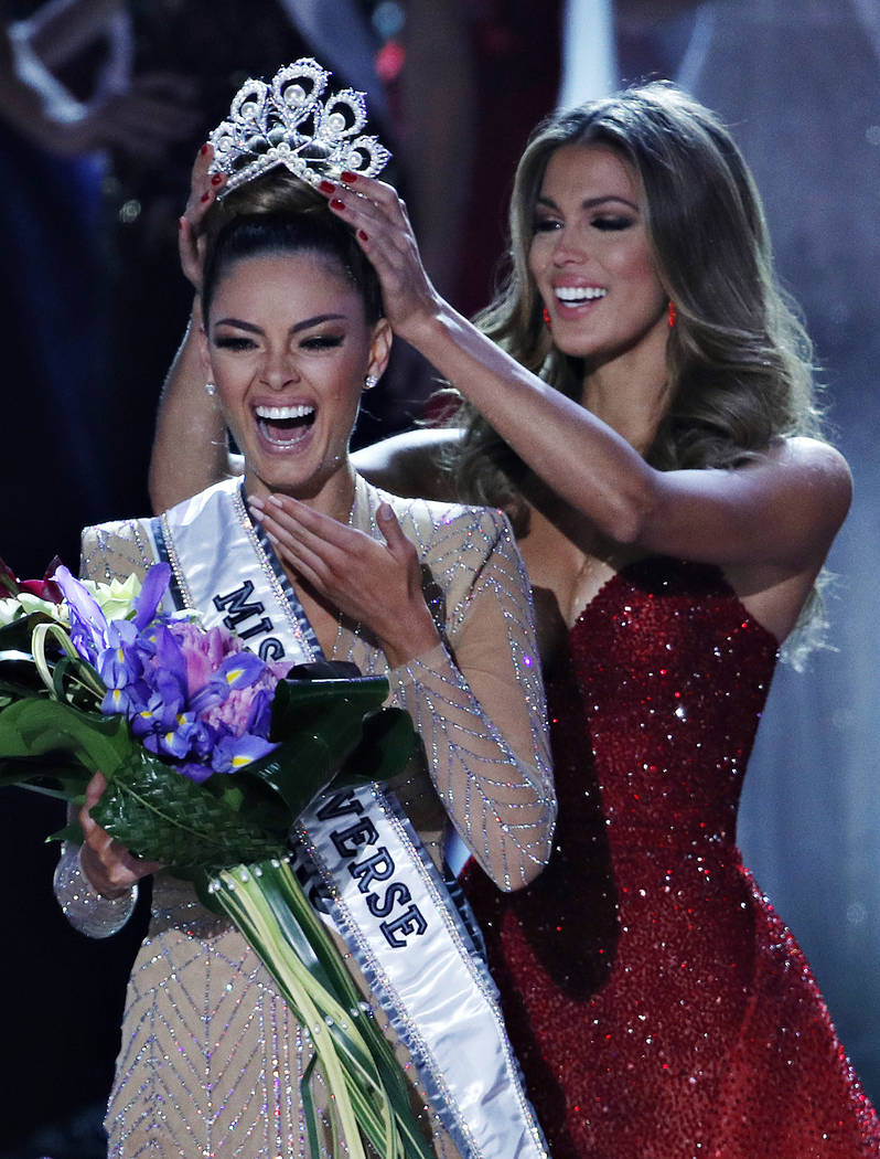Former Miss Universe Iris Mittenaere, right, crowns new Miss Universe Demi-Leigh Nel-Peters at the Miss Universe pageant Sunday, Nov. 26, 2017, in Las Vegas. (AP Photo/John Locher)