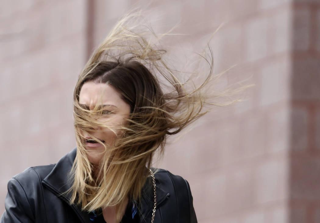 Darian McCauley has her hair blown by wind as she walks along Third Street in downtown Las Vegas as strong winds sweep through the Las Vegas Valley on Monday, Nov. 27, 2017. (Bizuayehu Tesfaye/Las ...