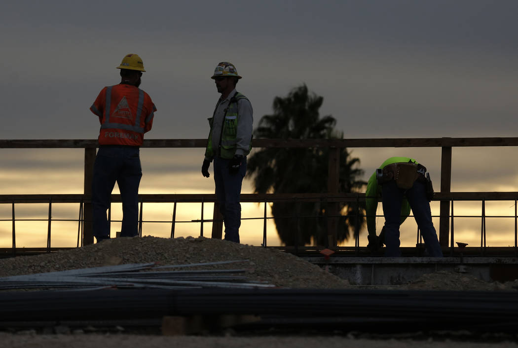 Construction workers are silhouetted as they work on Interstate 15, part of Project Neon, near the Charleston exit, early Monday, Nov. 27, 2017. (Bizuayehu Tesfaye/Las Vegas Review-Journal) @bizut ...