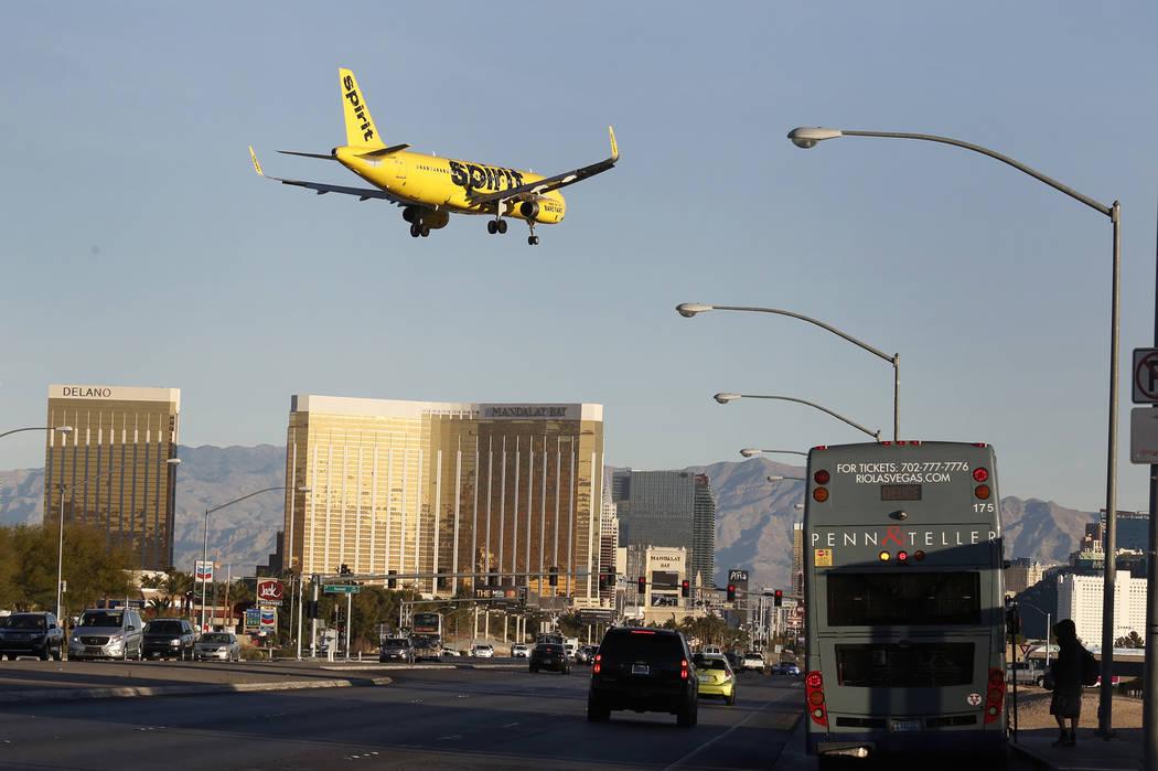A Spirit Airline plane flies over Las Vegas Boulevard to land at McCarran International Airport on Tuesday, Nov. 28, 2017, in Las Vegas. Bizuayehu Tesfaye Las Vegas Review-Journal @bizutesfaye