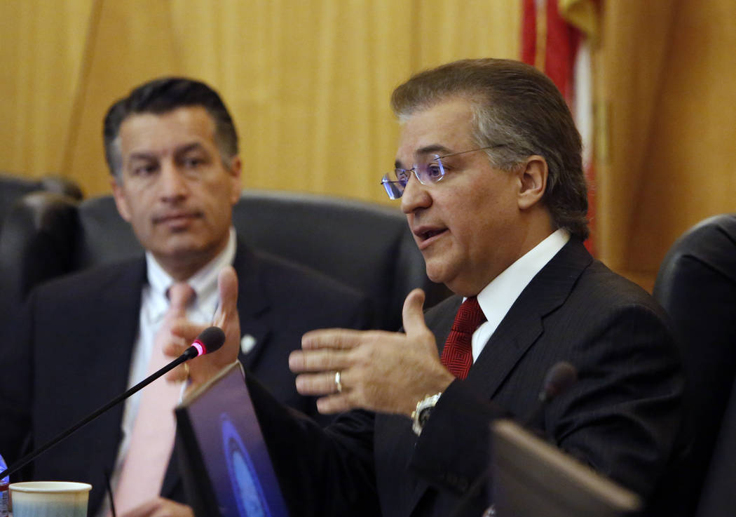 Gaming Commission Chairman, Tony Alamo, speaks as Gov. Brian Sandoval looks on during the Gaming Policy Committee, which meets at the direction of the governor, discusses marijuana policy involvin ...