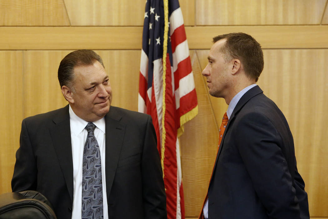 Keith Smith, left, of Boyd Gaming and Gaming Control Board Chairman, A.G. Burnett, chat before the Gaming Policy Committee, which meets at the direction of the governor, discusses marijuana policy ...