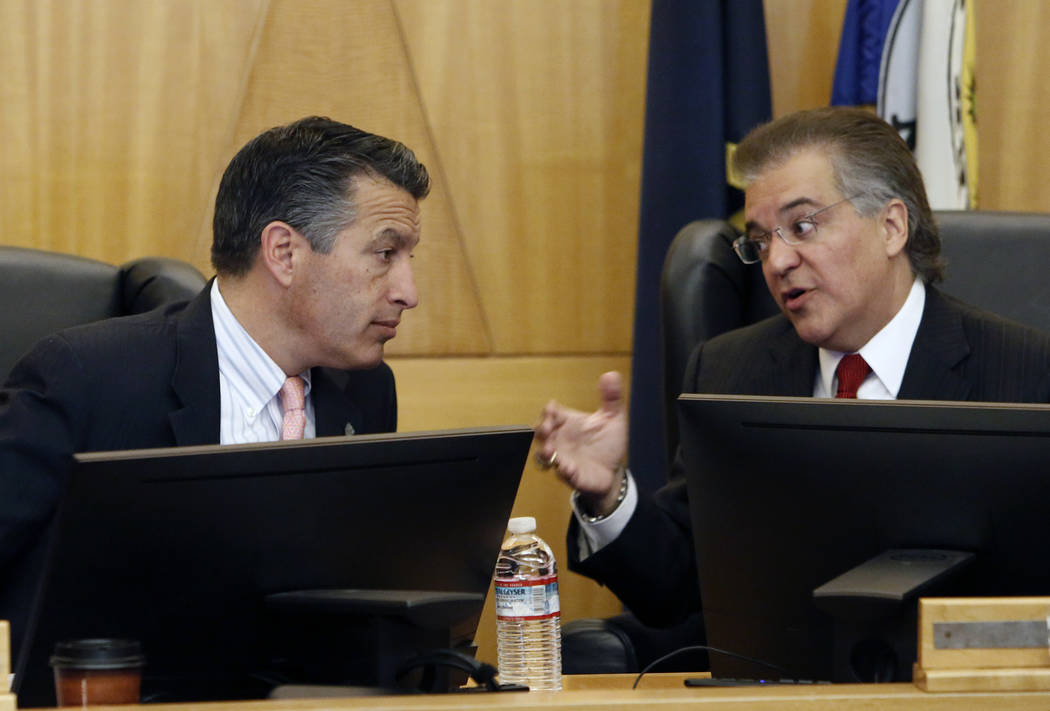 Gov. Brian Sandoval, left, and Gaming Commission Chairman Tony Alamo chat before the Gaming Policy Committee, which meets at the direction of the governor, discusses marijuana policy involving gam ...