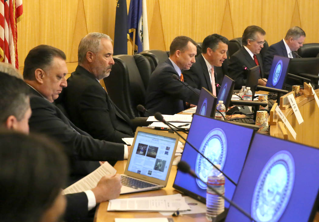 Gov. Brian Sandoval, third right, speaks during the Gaming Policy Committee, which meets at the direction of the governor, discusses marijuana policy involving gaming establishments on Wednesday,  ...