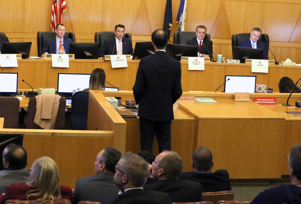 Gaming Control Board Chairman, A.G. Burnett, left, Gov. Brian Sandoval, Gaming Commission Chairman, Tony Alamo, and Jim Murren of MGM Resorts International, right, listen to Brian Barnes, Attorney ...