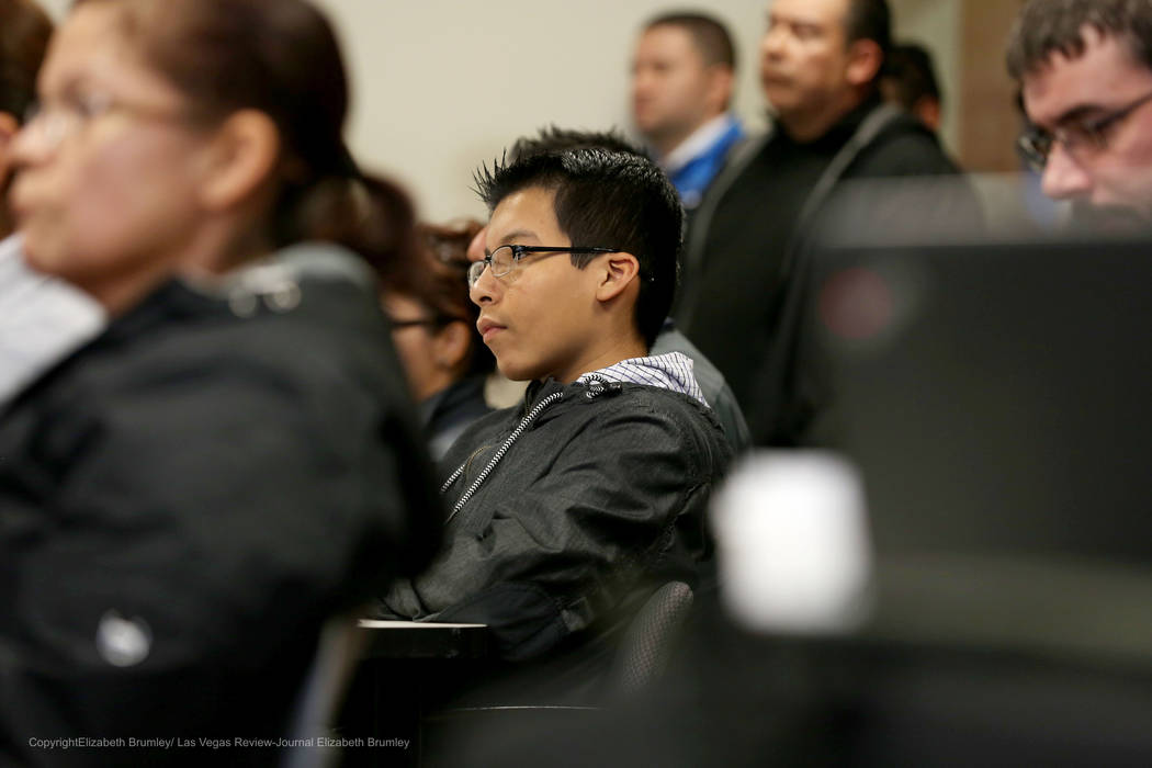 Erick Ruiz, a ninth grade student at Odyssey Charter High School, sits after sharing his opinion against transgender policies for the Clark County School District at  Nevada Department of Educatio ...