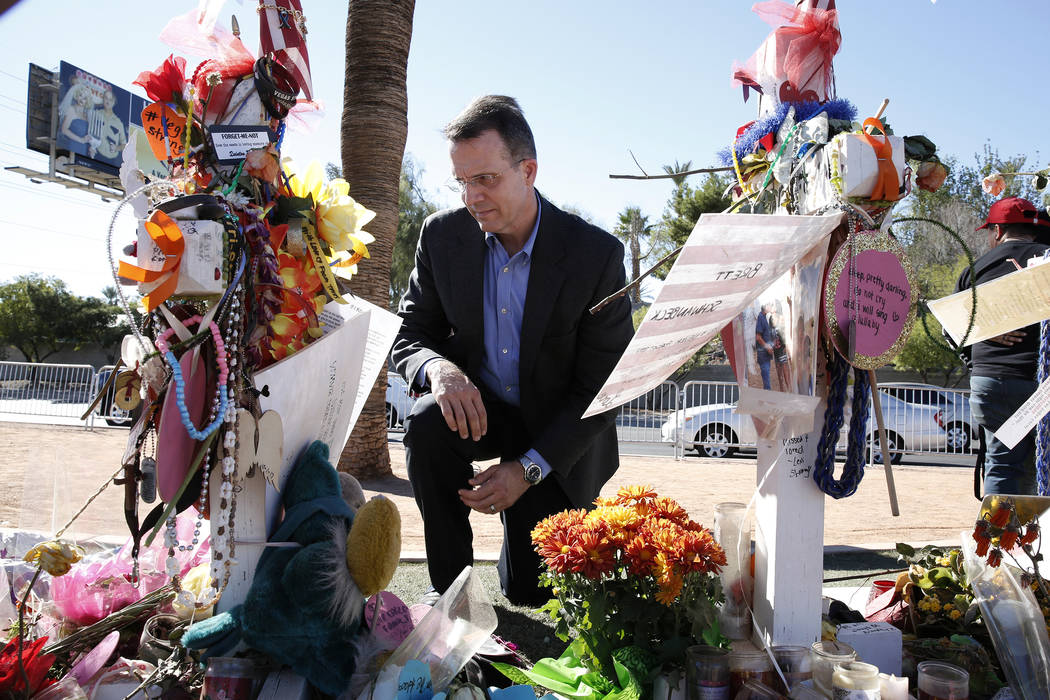 Jeff Dion, deputy executive director of the National Center for Victims of Crime, visits a memorial, honoring the victims of the 91 Harvest mass shooting, at the Welcome to Fabulous Las Vegas sign ...