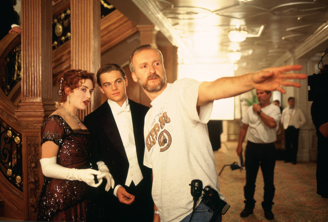 "Kate Winslet, Leonardo DiCaprio and writer-director James Cameron are shown on the set of ""Titanic."" (Paramount)"