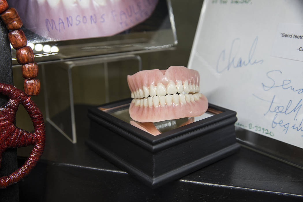 6b18a3a02b63 Charles Manson s false teeth are part of a larger display of his prison  artwork