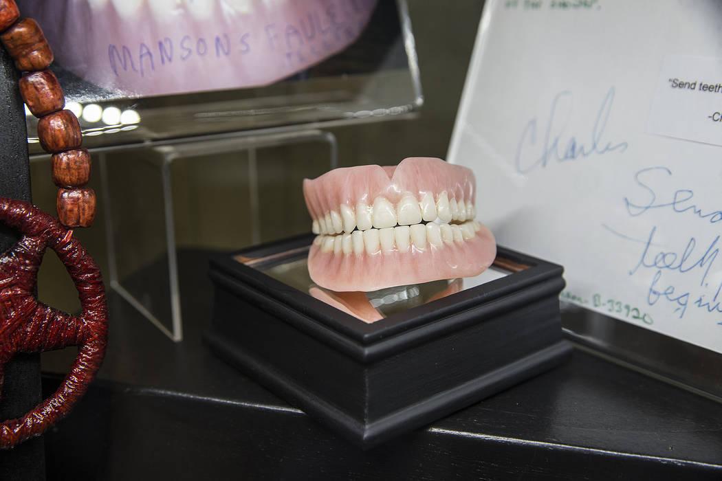 Charles Manson's false teeth are part of a larger display of his prison artwork, photographs and memorabilia at TV ghost hunter Bagans' Haunted Museum on Monday, Nov. 27, 2017, in Las Vegas. Benja ...