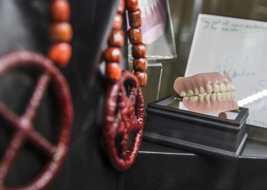 Charles Manson's false teeth are part of a larger display of his prison artwork, photographs and memorabilia at TV ghost hunter Bagans' Haunted Museum on Monday, Nov. 27, 2017, in Las Vegas. Benja ...