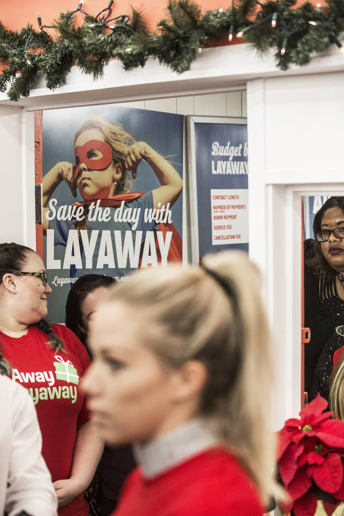 Kendra Wilkinson presents paid-off layaway items to Kmart shoppers ...