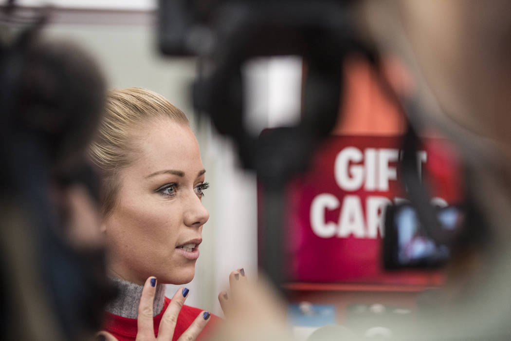Former Playboy model and reality TV star Kendra Wilkinson discusses her partnership with nonprofit Pay Away the Layaway, which pays off layaway items at Kmart on Tuesday, Nov. 28, 2017, in Las Veg ...