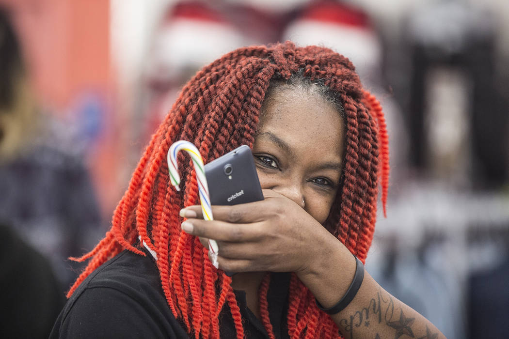 Wileena Smith holds back tears after realizing her layaway items had been paid for by nonprofit Pay Away the Layaway at Kmart on Tuesday, Nov. 28, 2017, in Las Vegas. Benjamin Hager Las Vegas Revi ...