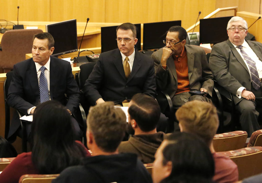 Scott Nielson, left, chairman of the Las Vegas Victims Fund committee, Victim advocate Jeff Dion, center, and Steve Rickman, second right, listen on Tuesday, Nov. 28, 2017 as victims and survivors ...