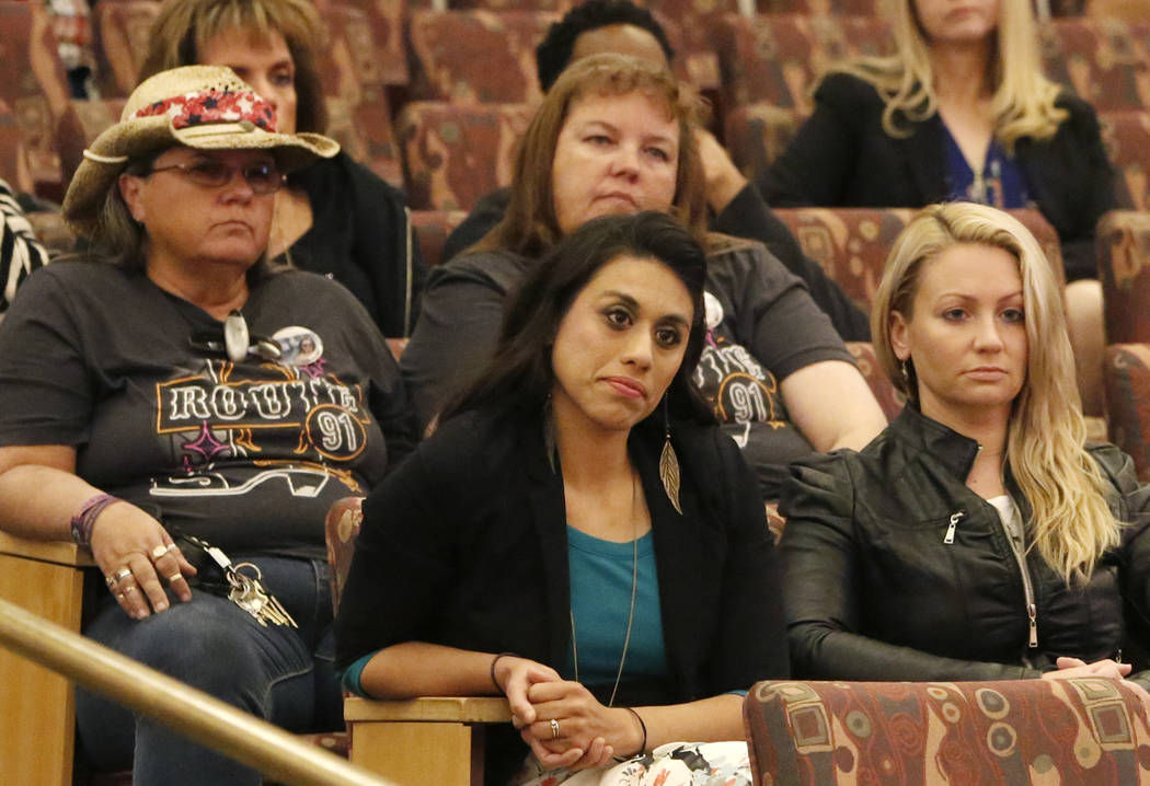 Victims and survivors of the Oct. 1 Las Vegas shooting, including Lillian Aguirre, front left, and Laura Puglia, right, attend the Las Vegas Victims Fund committee's town hall meeting Tuesday, Nov ...