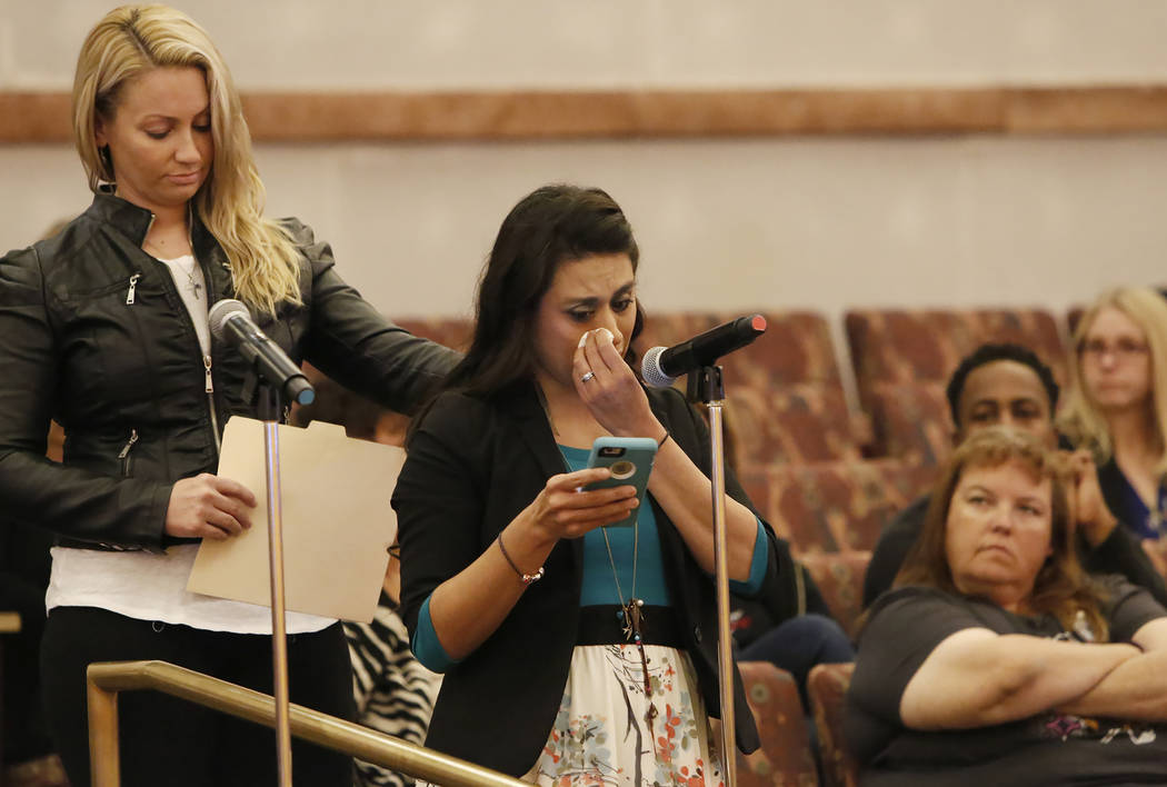 Lillian Aguirre, survivor of the Oct. 1 Las Vegas shooting, comforted by Laura Puglia, as she speaks before the Las Vegas Victims Fund committee Tuesday, Nov. 28, 2017, in Las Vegas. The Las Vegas ...