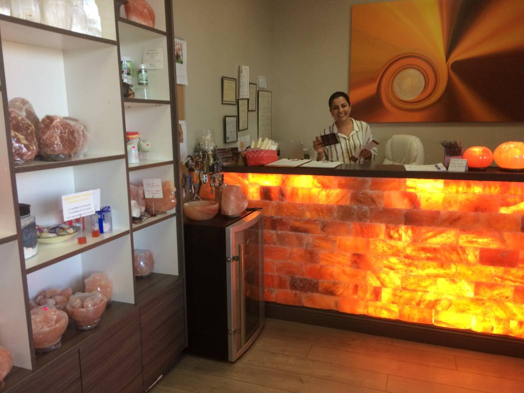 Ava Mucikyan, conducts business behind a Himalayan salt rock counter Nov. 1, 2017, while talking about her business, Salt Room LV, in Trails Village. The business' biggest draw is the salt cave, w ...