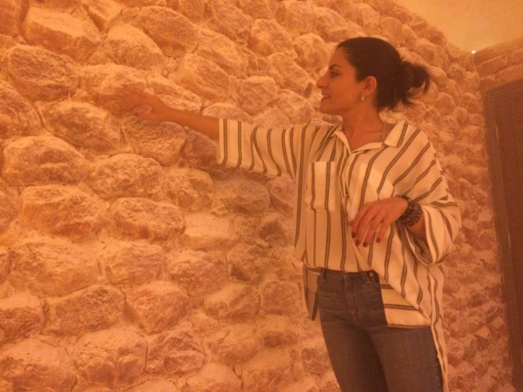 Ava Mucikyan, brushes off the minuscule layer of salt that results from her Himalayan salt cave Nov. 1, 2017, at  Salt Room LV, in Trails Village. She said she had to reinvent the business to keep ...