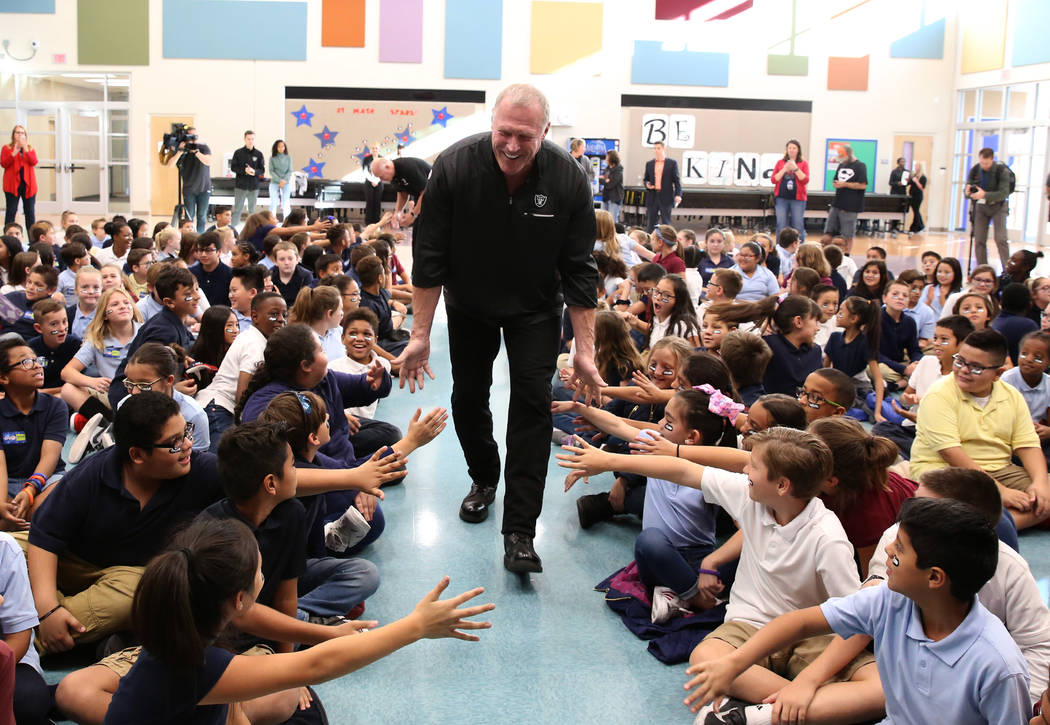 Linden King, a Raiders alumni, arrives at Josh Stevens Elementary School to attend the Raiders NFL Play 60 challenges event on Tuesday, Nov. 28, 2017, in Henderson. The school won the Raiders NFL  ...