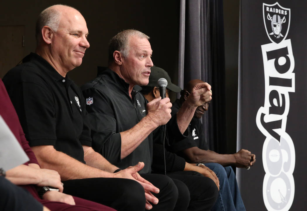 Jay Shroeder, left, a Raiders alumni, listens as Linden King speaks during the Raiders NFL Play 60 challenges event  at Josh Stevens Elementary School on Tuesday, Nov. 28, 2017, in Henderson. The  ...