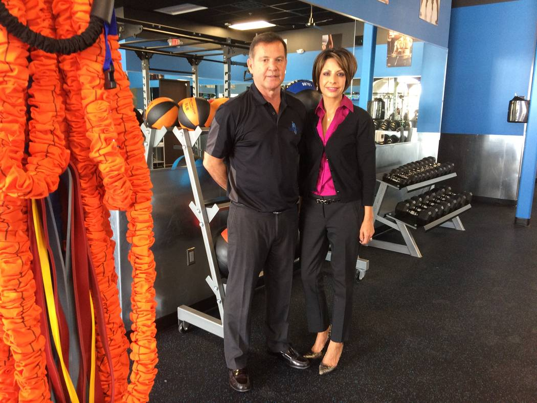 Gene and Lisa Carrejo pause in the workout gym portion of their new business, BioMetrix Life Las Vegas Nov. 6, 2017. Think workout gym with medical markers to determine how best to include supplem ...