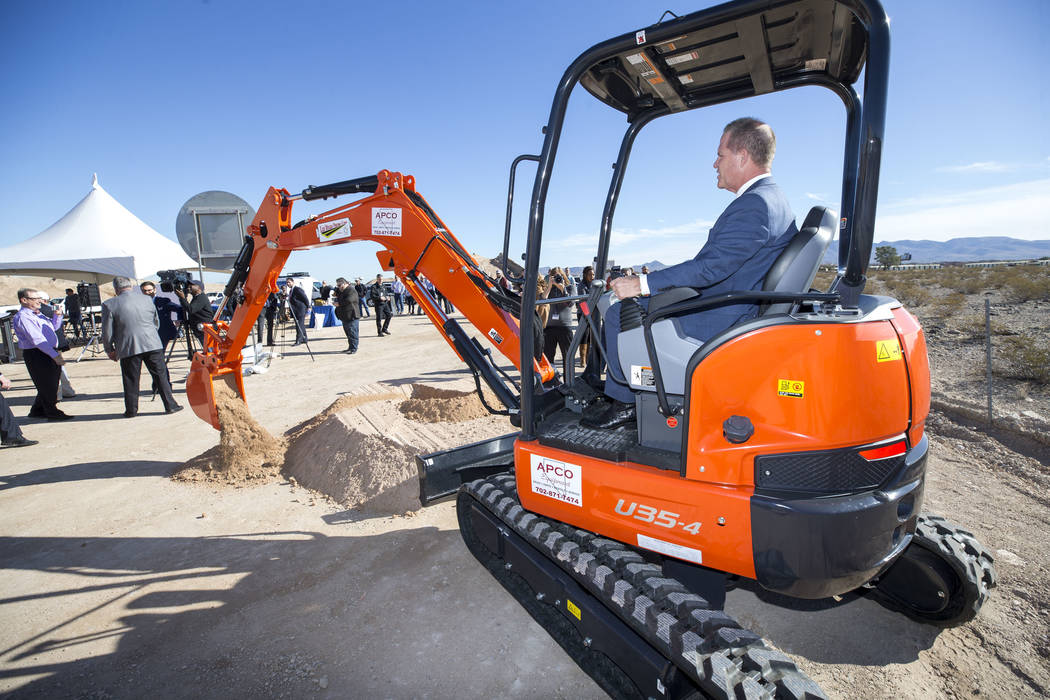 Nevada Lt. Gov. Mark Hutchison shovels dirt with an excavator during a groundbreaking ceremony for a $34 million Interstate 15 and Starr Avenue interchange project, Thursday, Nov. 30, 2017, in Las ...