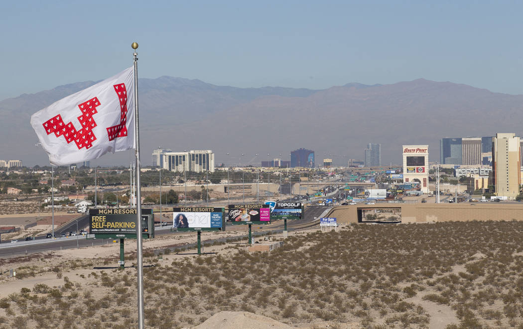 A flag honoring the 58 victims of the Route 91 Harvest festival shooting blows in the wind at the site of the $34 million Interstate 15 and Starr Avenue interchange project, Thursday, Nov. 30, 201 ...