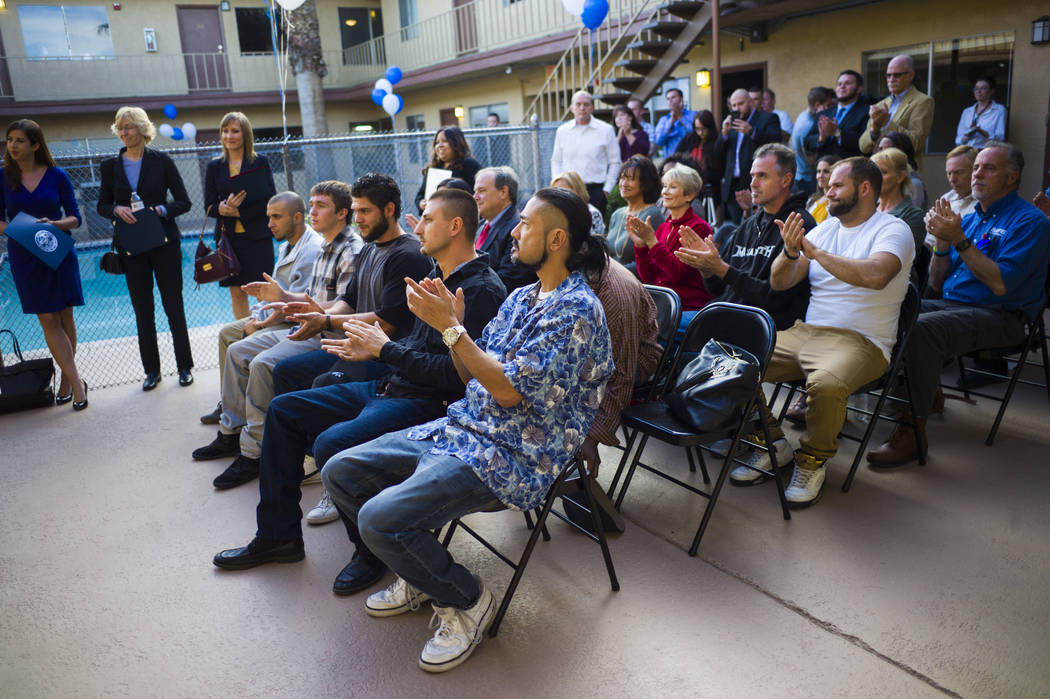 Program graduate Curtis Arakawa, center, claps during the anniversary celebration for Freedom House and Freedom Behavior Health in Las Vegas in Las Vegas on Wednesday, Nov. 29, 2017. The center is ...