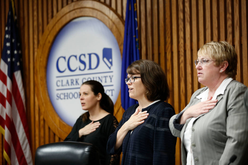 Members of the Clark County School Board including Lola Brooks, left, Erin Cranor and Chris Garvey during the Pledge of Allegiance before a meeting at Edward Greer Education Center in Las Vegas, T ...