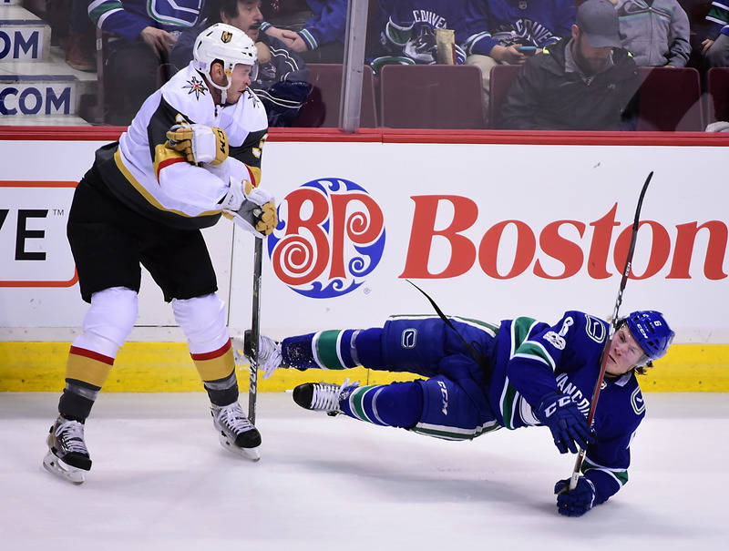 Nov 16, 2017; Vancouver, British Columbia, CAN; Las Vegas Knights defenseman Brayden McNabb (3) collides with Vancouver Canucks forward Brock Boeser (6) during the first half at Rogers Arena. Mand ...