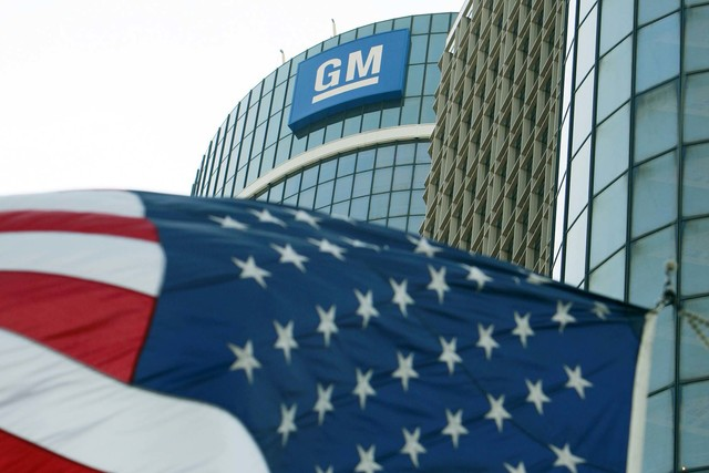 The General Motors logo is seen outside its headquarters at the Renaissance Center in Detroit. (Jeff Kowalsky/Reuters)