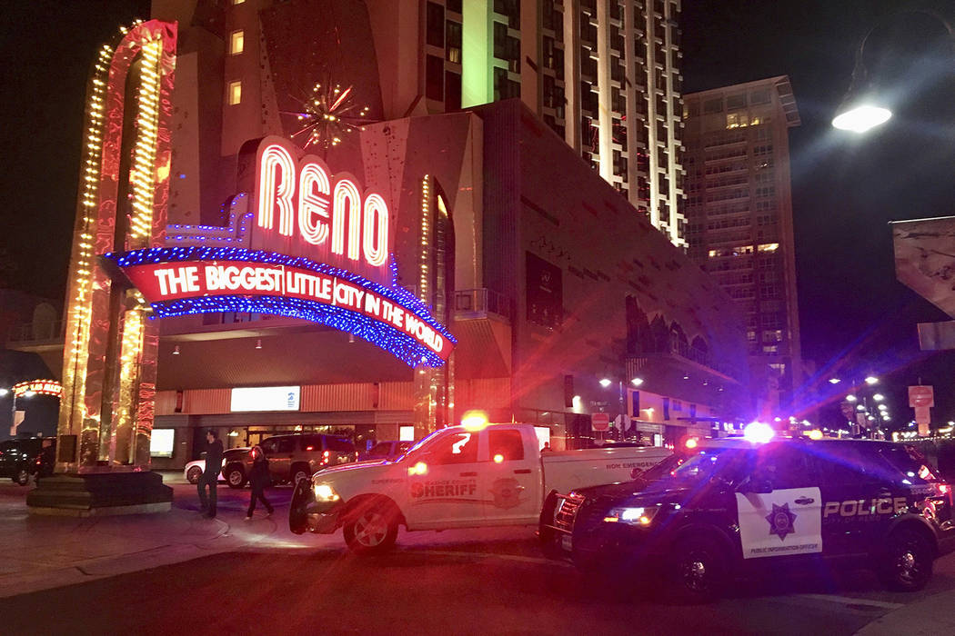 Police respond to an active shooter at a high-rise building of luxury condominiums in Reno, Nev., Tuesday, Nov. 28, 2017.  (Andy Barron/The Reno Gazette-Journal via AP)