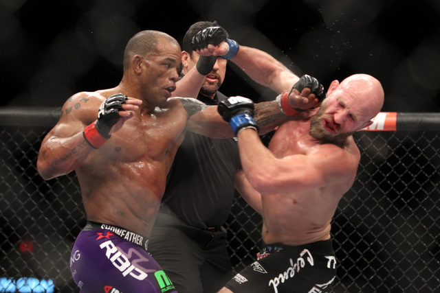 Hector Lombard hits Josh Burkman with a left during their fight at UFC 182 Saturday, Jan. 3, 2015 at the MGM Grand Garden Arena. (Sam Morris/Las Vegas Review-Journal)