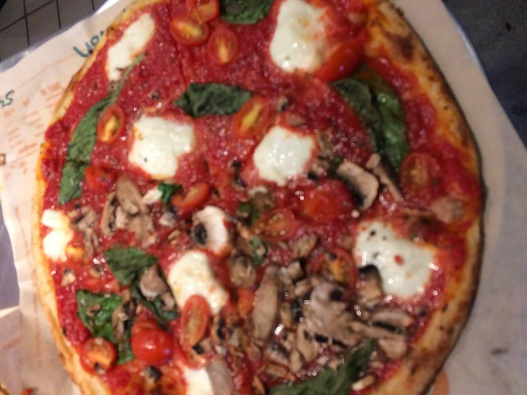 A Blaze Pizza with all the works is seen. Patrons can custom build their pizza pies any way they want. (Jan Hogan/View)