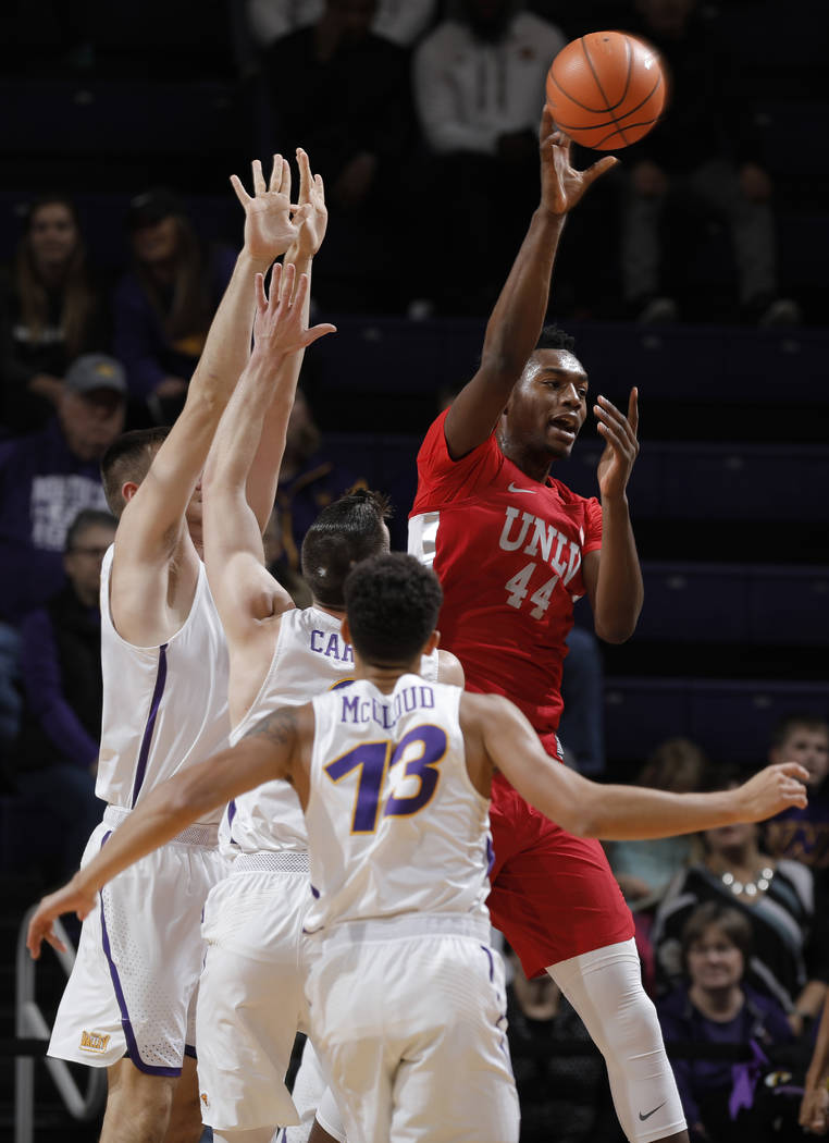 UNLV's Brandon McCoy, right, passes the ball out to the perimeter during the first half of an NCAA college basketball game against Northern Iowa on Wednesday, Nov. 29, 2017, in Cedar Falls, Iowa.  ...