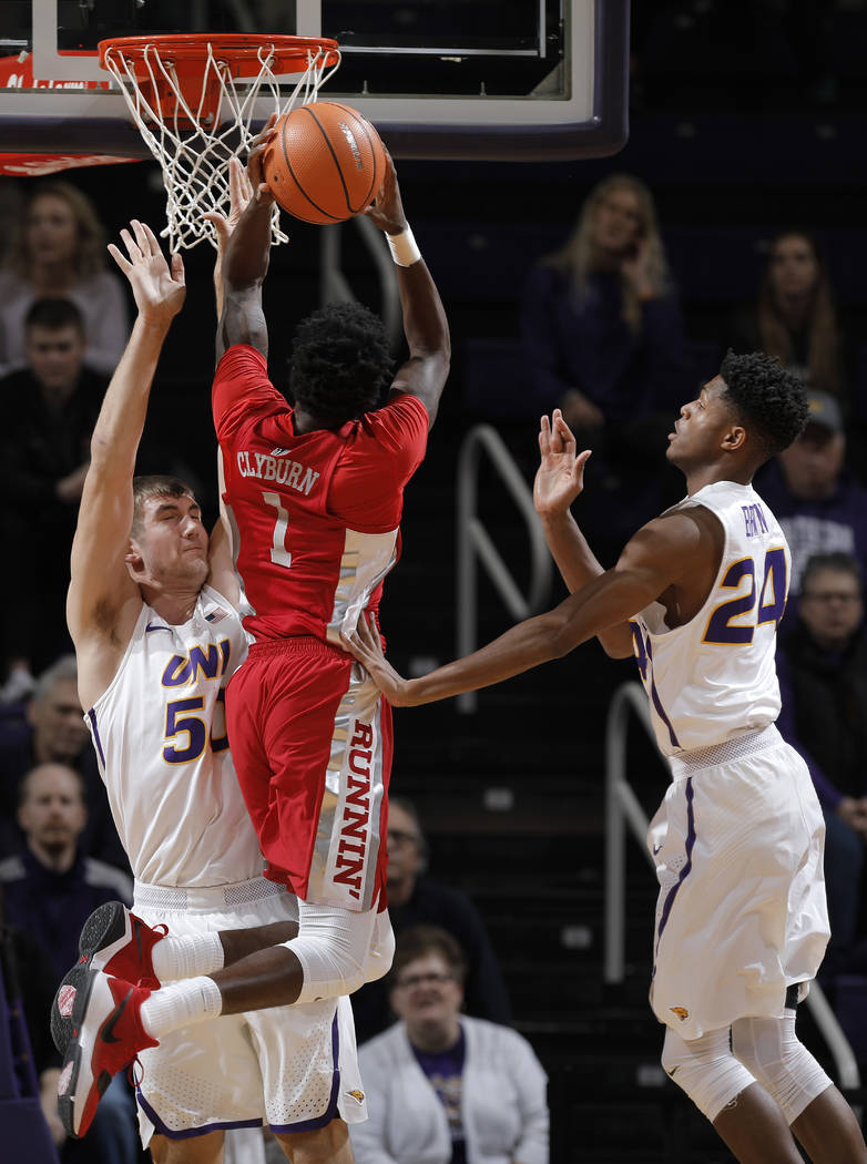 Northern Iowa's Austin Phyfe, left, fouls UNLV's Kris Clyburn on a shot as Isaiah Brown, right, defends in the first half of an NCAA college basketball game in Cedar Falls, Iowa, Wednesday, Nov. 2 ...
