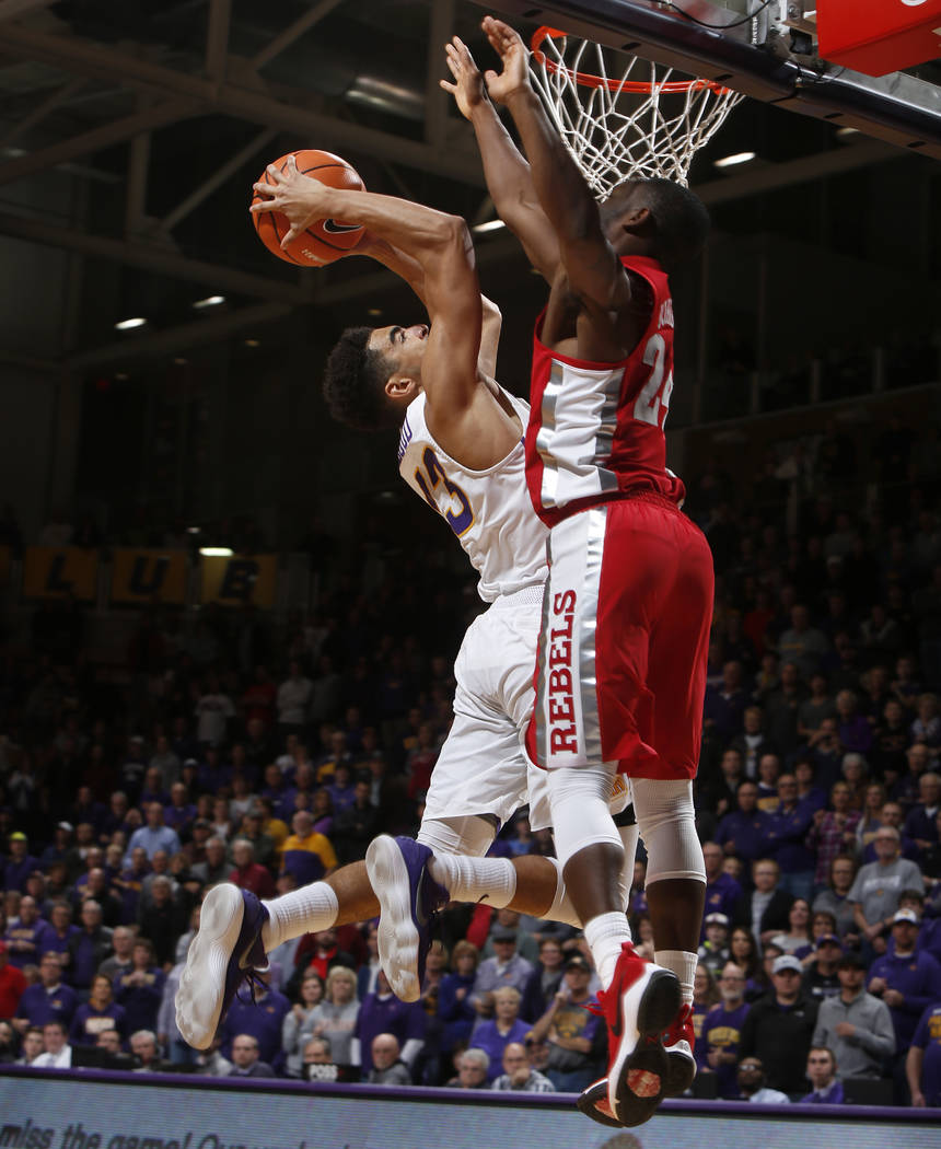 Northern Iowa's Juwan McCloud, left, goes up for a shot as he is fouled by UNLV's Jordan Johnson, right, in overtime of an NCAA college basketball game in Cedar Falls, Iowa, Wednesday, Nov. 29, 20 ...