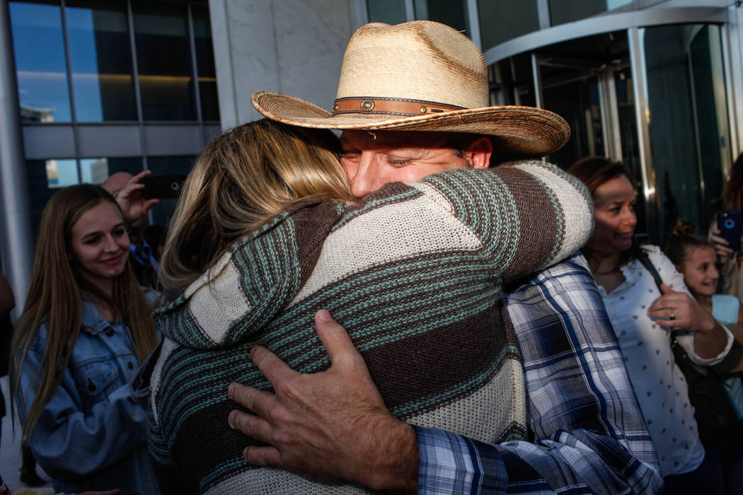 Ammon Bundy embraces a supporter outside the Lloyd George U.S. Courthouse in Las Vegas after being released from custody Thursday, Nov. 30, 2017. Bundy's trial related to a 2014 Bunkerville stando ...