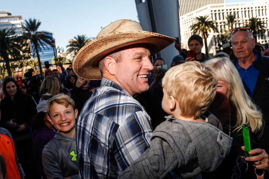 Ammon Bundy embraces his children outside the Lloyd George U.S. Courthouse in Las Vegas after being released from custody Thursday, Nov. 30, 2017. Bundy's trial related to a 2014 Bunkerville stand ...