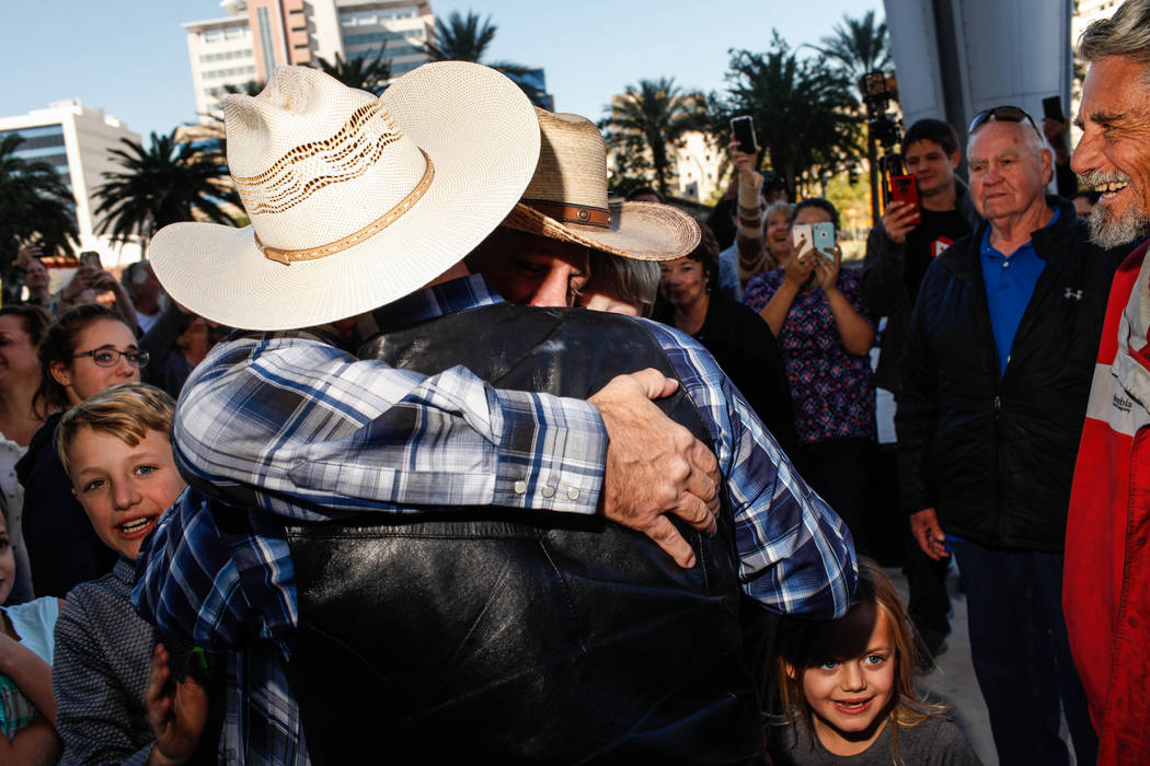 Ammon Bundy, right, hugs his brother Ryan Bundy outside the Lloyd George U.S. Courthouse in Las Vegas after being released from custody Thursday, Nov. 30, 2017. Ammon Bundy's trial related to a 20 ...