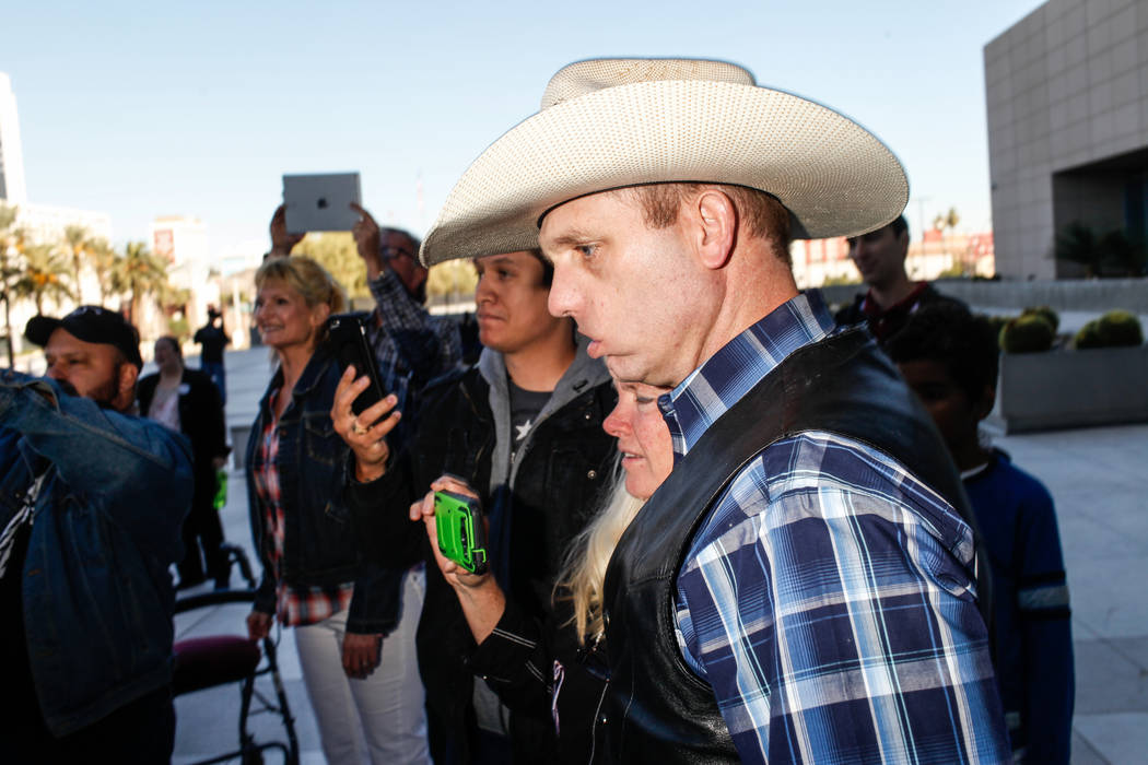 Ryan Bundy stands outside the Lloyd George U.S. Courthouse in Las Vegas after his brother Ammon Bundy's release from custody Thursday, Nov. 30, 2017. Ammon Bundy's trial related to a 2014 Bunkervi ...