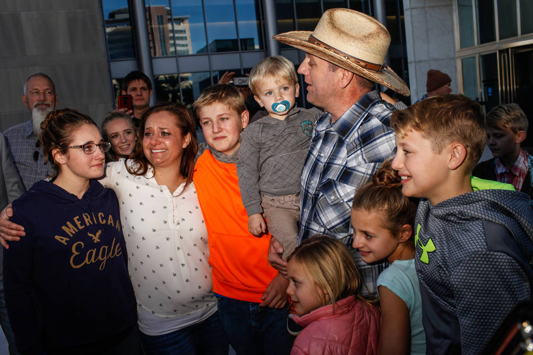 Ammon Bundy embraces his family outside the Lloyd George U.S. Courthouse in Las Vegas after being released from custody Thursday, Nov. 30, 2017. Bundy's trial related to a 2014 Bunkerville standof ...