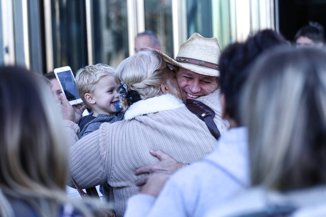 Ammon Bundy embraces supporters outside the Lloyd George U.S. Courthouse in Las Vegas, after being released from custody Thursday, Nov. 30, 2017. Bundy's trial related to a 2014 Bunkerville stando ...