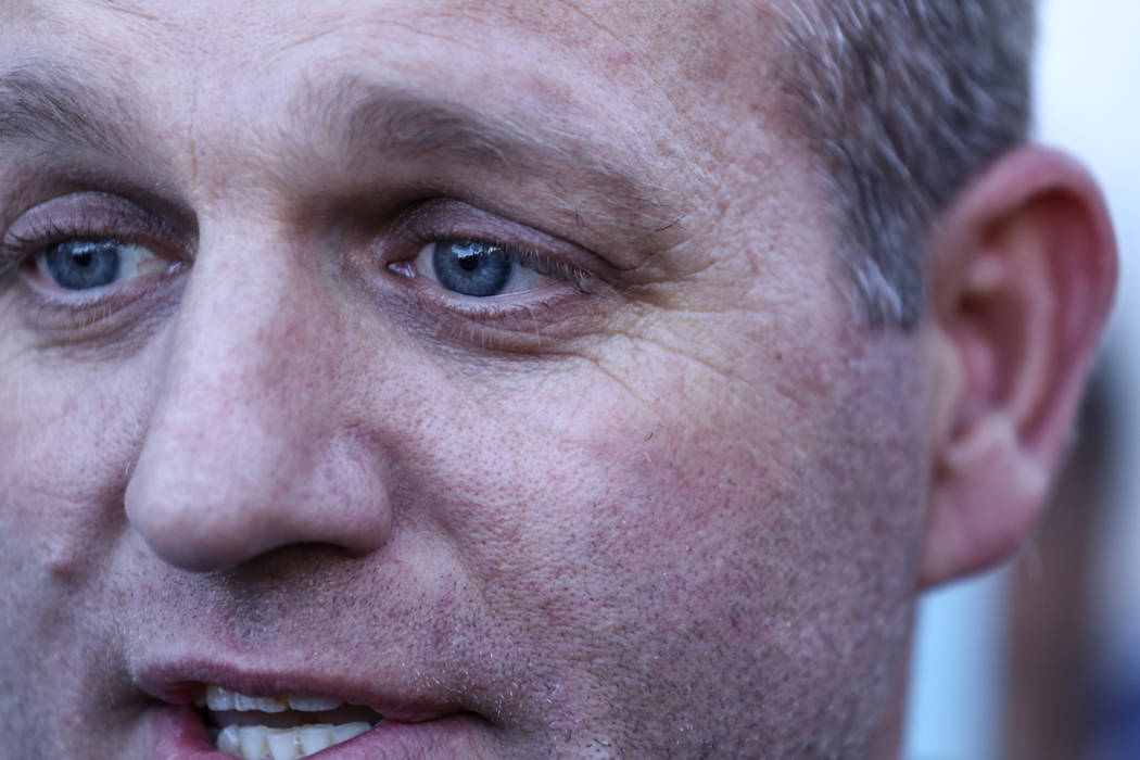 Ammon Bundy answers questions from media outside the Lloyd George U.S. Courthouse in Las Vegas after being released from custody Thursday, Nov. 30, 2017. Bundy's trial related to a 2014 Bunkervill ...