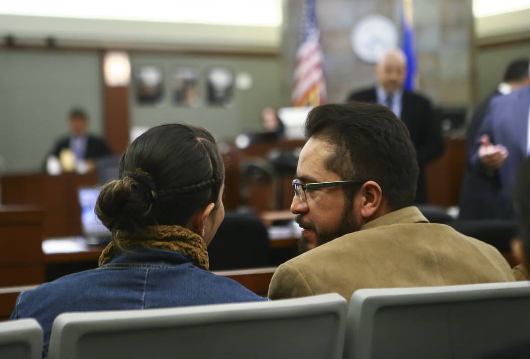 Arturo Martinez, right, whose wife and daughter were killed, during the sentencing phase of the trial of Bryan Clay at the Regional Justice Center in Las Vegas on Thursday, Nov. 30, 2017. Clay was ...