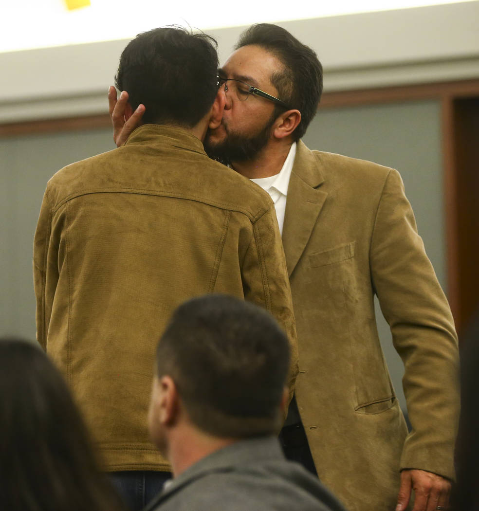 Arturo Martinez, whose wife and daughter were killed, embraces his son Cristopher after testifying during the sentencing phase of the trial of Bryan Clay at the Regional Justice Center in Las Vega ...
