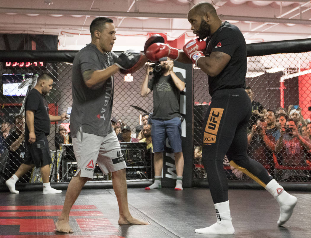 UFC light heavyweight champion Daniel Cormier,right, hits mitts during UFC 214 open workouts at the UFC Gym in La Mirada, Calif., on Thursday, July 27, 2017. Heidi Fang Las Vegas Review-Journal @H ...