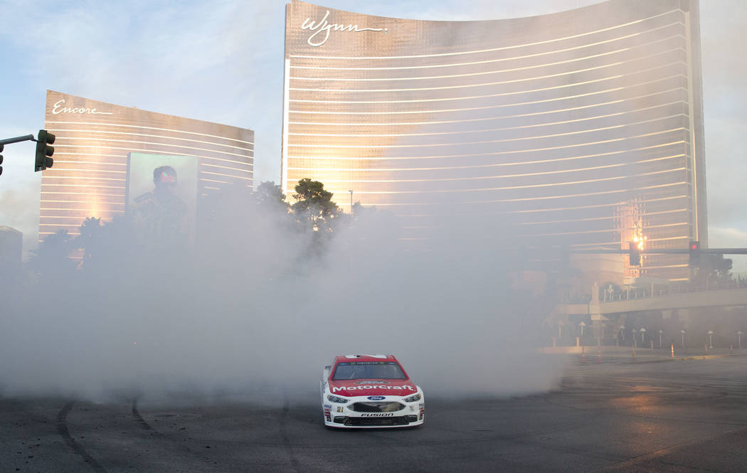 Race car driver Ryan Blaney (21) burns out on the Vegas Strip during NASCAR's Victory Lap on Wednesday, Nov. 29, 2017.  Richard Brian Las Vegas Review-Journal @vegasphotograph